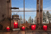 Country Christmas decoration: wooden window decorated with red c — Stock Photo