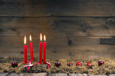 Advent or christmas wreath with four red wax candles. — Stockfoto