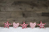 Wooden christmas background with red white checked hearts and st — Stock Photo