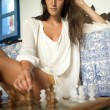 Young brunette playing chess — Stock Photo