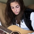 Stock Photo: Teenage girl playing guitar