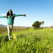 Teenage girl in a field — Stock Photo