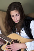 Teenage girl playing the guitar — Stock Photo