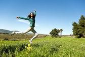 Teenage girl in a field — Stock Photo