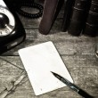 Blank paper sheet on an old desk — Stock Photo #34488057