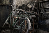 Bicycle in a dirty warehouse — Stock Photo
