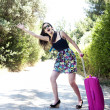 Travel young woman hitchhiking — Stock Photo