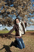 Teenage girl enjoying the beautiful sunny day in a field — Stock Photo