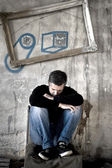 Depressed man sitting in a chair — Foto de Stock