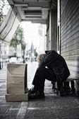 Beggar in the street — Stock Photo