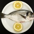 Fresh bream on a plate — Stock Photo