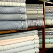 Stock Photo: Colorful textile on shelves