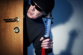 Thief in a house — Stock Photo