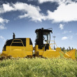 Bulldozer in a field — Stock Photo