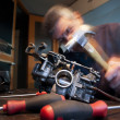 Stock Photo: Mecanic repairs carburetor