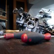 Stock Photo: Tools and carburetor