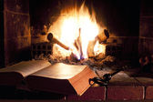 Relaxing near the fireplace — Stock Photo