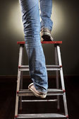 Man climbing on ladder — Stock Photo