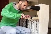 Man repairing a sofa — Stock Photo