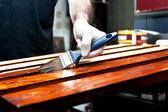 Varnishing wooden boards — Stock Photo
