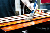Varnishing wooden boards — Stock Photo