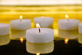 Candles on blurred out background — Stock Photo