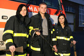 Firefighter and girls — Stock Photo