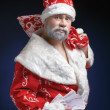 Portrait of Santa, who holds the money on a blue background — Stock Photo