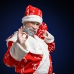 Santa Claus shows OK sign on a dark background — Stock Photo