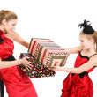 Sisters with gift box — Stock Photo