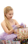 Girl rejoicing gifts — Stock Photo