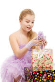 Girl rejoices gifts — Stock Photo