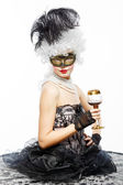 Princess in a black dress with a glass of wine. — Stock Photo