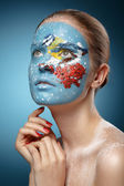 Beautiful fashion model with face art in winter style. Textural — Stock Photo