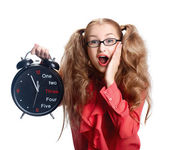 Beautiful girl in glasses with a big clock in panic — Stockfoto