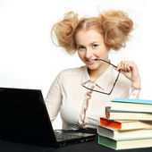 Beautiful girl with glasses working on computer — 图库照片