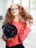Smiling Beautiful girl with a big clock in office — Foto Stock
