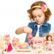 Little girl playing with dolls. — Stock Photo