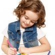 Stockfoto: Cheerful little girl with sketch pen drawing in kindergarten