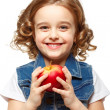 Little girl in a denim jacket holding a red apple. Isolated on w — Stock Photo #41299353