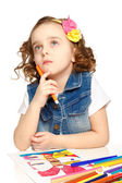Cheerful little girl with felt-tip pen drawing in kindergarten — Stock Photo