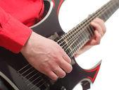 Rock guitarist plays solo guitar — Stock Photo