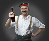 Cheerful man with a beer bottle. — Foto de Stock