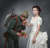 German soldier kissing a lady's hand — Stock Photo