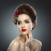 Woman Touching her Face. Beautiful girl with colored make up and — Foto Stock