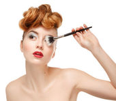 Beauty portrait of pretty woman with brush for makeup — Stock Photo