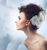 Fashion Beauty Model Girl with Flowers Hair. Bride. — Stock Photo