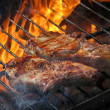 A top sirloin steak flame broiled on a barbecue, shallow depth o — Stock Photo
