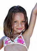Little girl having fun at the beach — Stock Photo