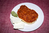 Ajvar - Roasted red pepper and eggplant spread on bread with white cheese — Stock Photo
